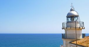 Lighthouse At Mediterranean Sea. Lighthouse With Mediterranean Sea As Background stock footage