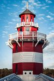 Lighthouse meets blue sky stock photography