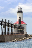 The Lighthouse at Michigan City, Indiana. An elevated catwalk leads to the historic East Pierhead Lighthouse on Lake Michigan at Michigan City, Indiana royalty free stock images