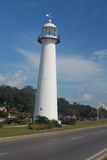 Lighthouse in the middle of the highway royalty free stock photos