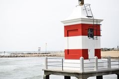 Lighthouse in the middle of the sea with white and red stripes Royalty Free Stock Images