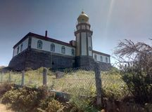 Lighthouse and military complex on the island royalty free stock images