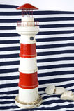 Lighthouse model on blue strips Royalty Free Stock Photo