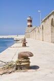 Lighthouse on Monopoli Old Port. Apulia. Stock Photography