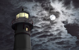 Lighthouse with moon. Night scene of a lighthouse with dramatic sky. Scene is a composite where lighthouse has been altered to change colors to traditional red Stock Photos