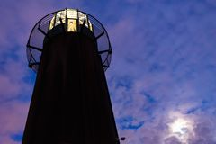 Lighthouse and moon stock photography