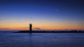 Lighthouse with moon on the sky Stock Photography