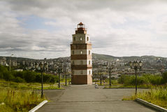 Lighthouse And Murmansk City. Cityscape of murmansk - a city in northern russia. beautiful brick lighthouse Royalty Free Stock Photo