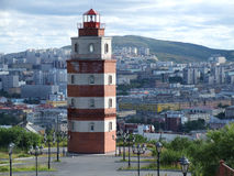 Lighthouse and Murmansk city panorama Royalty Free Stock Image