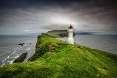 Lighthouse in mykines faroe Stock Image