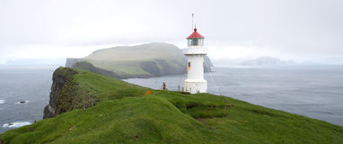 Lighthouse on Mykines Holmur Stock Image