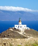 Lighthouse on Mykonos island. Scenic view of lighthouse on Mykonos island with sea in background, Cyclades Islands, Greece Royalty Free Stock Image