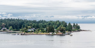Lighthouse on Nanaimo Point. Homes along the coast of Canada near Nanaimo Stock Photos