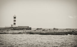 Lighthouse near the bay. Royalty Free Stock Image