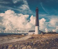 Lighthouse near beautiful bay Royalty Free Stock Images
