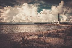 Lighthouse near beautiful bay Stock Images
