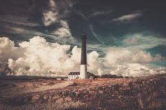 Lighthouse near beautiful bay Stock Image