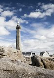 Lighthouse near the coast in the ocean in Penmarch, Brittany, Fr Royalty Free Stock Photo