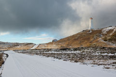 Lighthouse near geothermal area Gunnuhver at winter, Reykjanes Peninsula, Iceland. Empty road and lighthouse near geothermal area Gunnuhver at winter, Reykjanes royalty free stock image