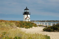 Lighthouse near Nantucket, Mass. A charming, small lighthouse capped by a single fresnel light encased in a black cupola sits on a sandy island near Nantucket Royalty Free Stock Photography