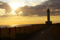 Lighthouse Near Ocean during Golden Hour Royalty Free Stock Images
