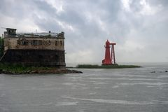 Lighthouse near the old fort. The Fort Of Kronshlot. Kronshtadt Stock Photography