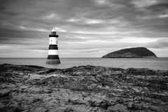 Lighthouse. Near Puffin island in Wales in black and white stock photo