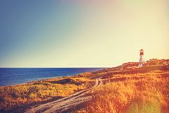 Lighthouse near a sea in autumn time Royalty Free Stock Photo