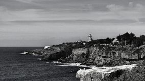 LightHouse near seaside. Rock formation seaside landscape lighthouse waves Royalty Free Stock Photo