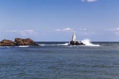Lighthouse near to the coast Stock Photo
