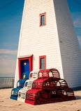 Lighthouse in new brunswick. Colorful Arcadian lighthouse on the coast of new brunswick Royalty Free Stock Photo
