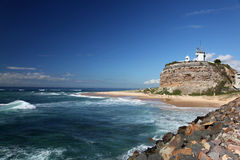 Lighthouse - Newcastle Australia. Nobbys Lighthouse - Famous landmark in Newcastle Australia. This landmark is often used for promotional material for Newcastle royalty free stock photo