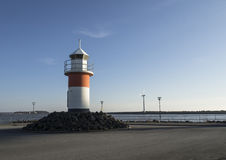Lighthouse next to sea Stock Photography