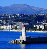 Lighthouse in Nice Cote d'Azur France. Lighthouse in the bay of the city on a background of mountains Royalty Free Stock Photos