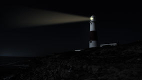 Lighthouse at night. A lighthouse with the beacon lighting the dark night sky Stock Image