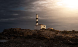 Lighthouse. In the night with cloudy sky Stock Photo