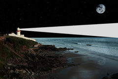 Lighthouse night light. Lighthouse captured on the high ground overlooking the cliffs at night Royalty Free Stock Photos