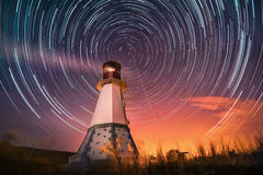 Lighthouse with night sky at background stars trails Royalty Free Stock Photos