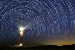 Lighthouse at night with star trails at the center. At Ouddorp, the Netherlands stock images