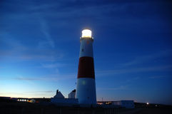 Lighthouse Nightscene. Lighthouse on a Seashore - Nightscene Stock Image