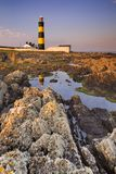 Lighthouse in Northern Ireland at sunset royalty free stock photo