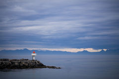 Lighthouse in Norway. Lighthouse on the stony coast in Norway Stock Image