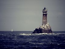 Lighthouse in the ocean Stock Photography