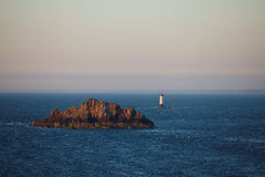 Lighthouse in the ocean. Royalty Free Stock Images