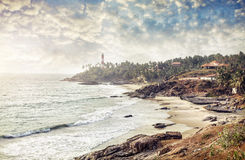 Lighthouse and ocean. Lighthouse on the hill near the ocean at blue sky with clouds in Kovalam, Kerala, India royalty free stock images