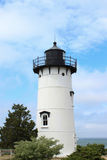 Lighthouse by Ocean in Cape Cod. Image of white lighthouse with black top and trim by the ocean in Cape Cod Massachusetts, USA Stock Images