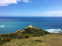 Lighthouse and ocean at Cape Reinga, Northland, New Zealand Stock Photography