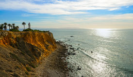 Lighthouse at the ocean. A lighthouse on a cliff with seascape in the afternoon Stock Photo