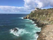 Lighthouse on the ocean in Cudillero Spain stock photos