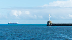 Lighthouse with oil tanker Stock Photography